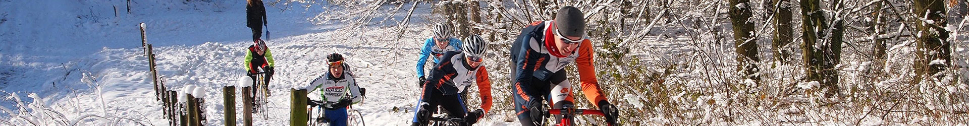 bike riders climbing on snowy hill